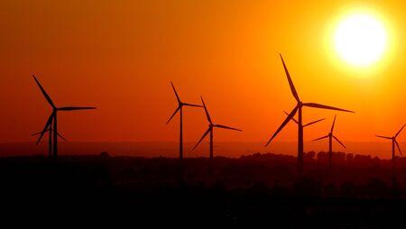 powerplants: Sunset with wind powerplants Stock Photo