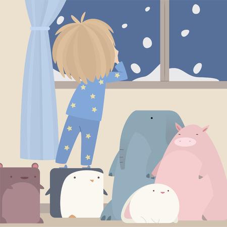 겨울 시간에 창 밖을 찾고 어린 소년