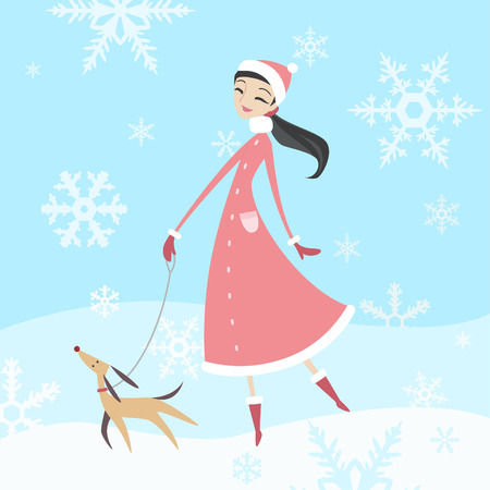long hair woman: woman taking her dog for a walk in winter time with her purebreed dog.