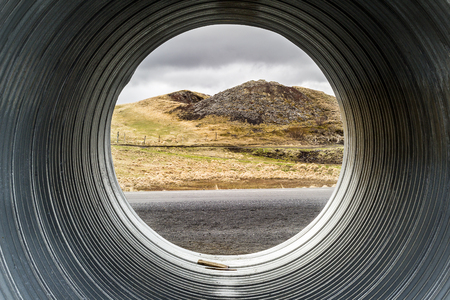 crater lake: Pseudocrater seen through pipe. Iceland