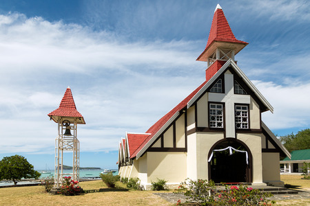 Notre Dame Auxiliatrice Church with distinctive red roof at Cap Malheureux, Mauritius