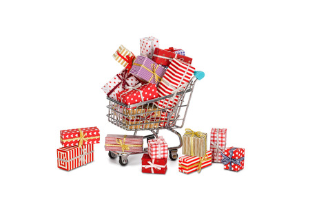 christmas debt: Shopping cart filled with christmas gifts and some fallen out. Christmas shopping theme.