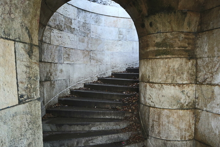 Spiral go upstairs. Thick brick-stone walls.