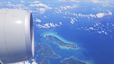 View of the Islands from the plane. The view from the top. The photo shows the engine of the aircraft. Imagens