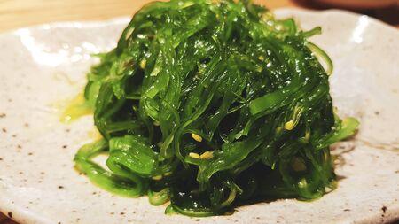 Japanese salad. Seaweed sprinkled with sesame. Healthy vegetarian seafood. Pickled salad.