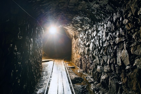 Mine tunnel with path - historical gold, silver, copper mine in Banska Stiavnica - Slovakia