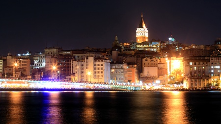 View of Istanbul and Galata tower, and bridge at night photo