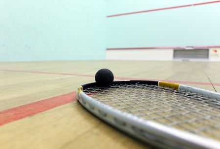raquet: Squash court and racket with ball - interior