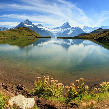 Beautiful lake with swiss mountain reflection, snow, and highest summits  Switzerland - Grindelwald