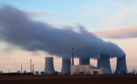 exhalation: Nuclear power plant with big tower  and smokestack Stock Photo