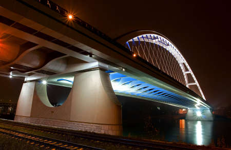 steel arch bridge: Bridge in Bratislava downtown during night  Slovakia  Name of bridge is Apollo