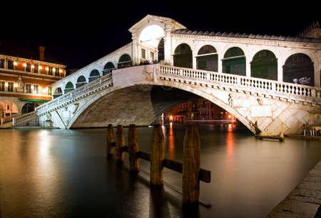 waterbus: Along Rialto Bridge, Venice at Night - Italy Stock Photo