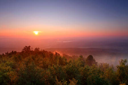 The Colourful Misty morning in the mountains photo