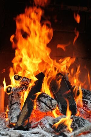 Hudge Fire in a fireplace with the wood Stock Photo - 12775512