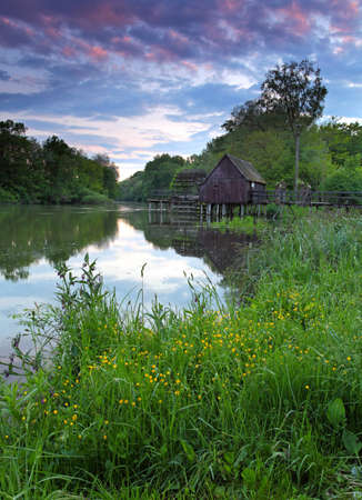 lake house: Spring landscape at sunset with watermill and river