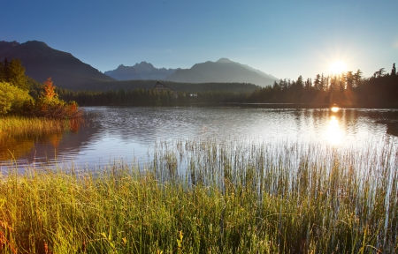 Sunset on mountain lake - Strbske pleso in Slovakia  photo