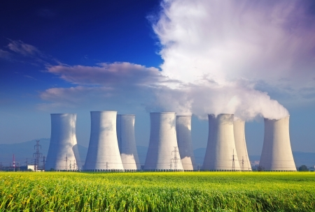 global cooling: Nuclear  plant with yellow field and big blue clouds Editorial
