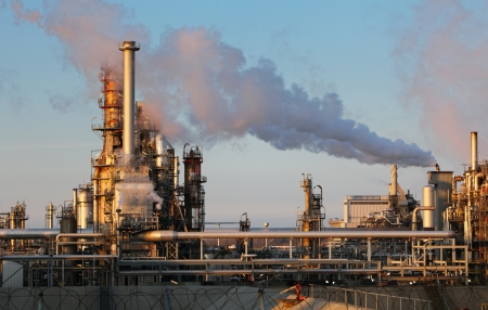 coal plant: Smoke from the pipes on oil and gas refinery Stock Photo
