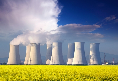 global cooling: Nuclear power plant with yellow field and big blue clouds
