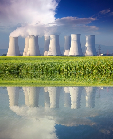 cooling towers: Nuclear power plant with reflection in water at spring