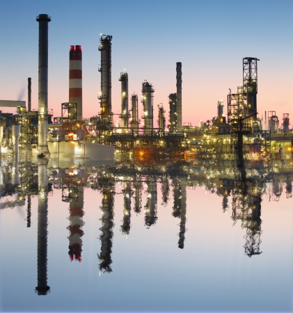 Oil and gas refinery with reflection in water - Petrochemical factory