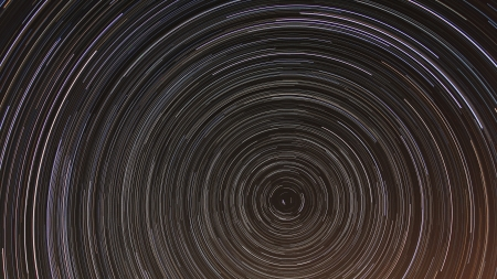 time lapse: Cumulative time lapse of star trails in night sky
