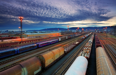 goods train: Freight Station with trains Stock Photo