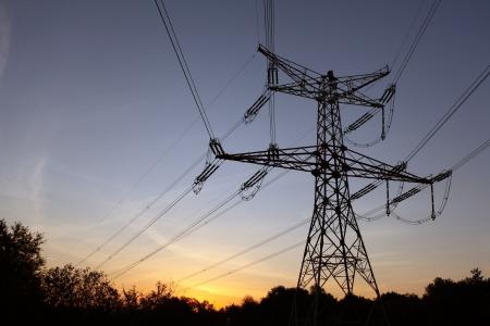 electric line: Electricity pylon at orange sunset