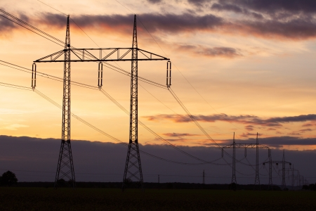 Electricity pylon on sunset - power energy photo