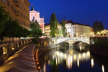 slovenia: Ljubljana at night, with the Triple Bridge Slovenia Stock Photo
