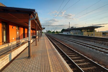 railroad station platform: passenger train station Stock Photo