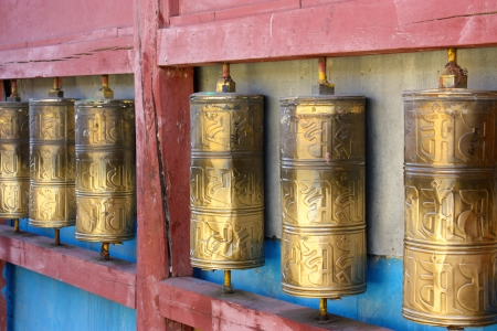 Row of buddhist prayer wheels in Gandan Monastery, Mongolia photo