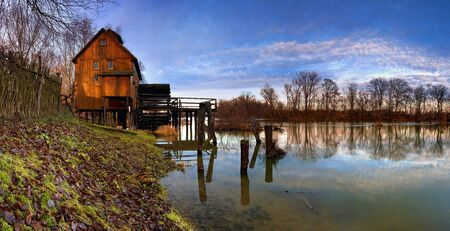 watermill: River reflection with watermill and tree
