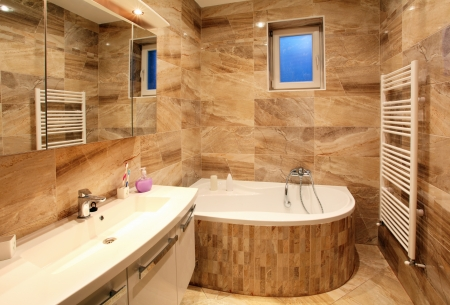 bathroom interior: bathroom in luxury home with bath and furniture