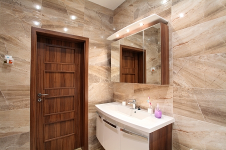 bathroom in luxury  home with bath and furniture photo