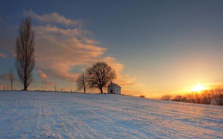 Winter sunset on field Stock Photo - 17309707