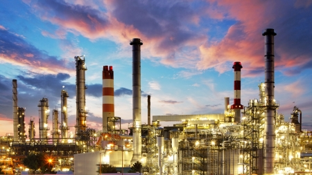 smokestack: Oil and gas industry - refinery at twilight - factory - petrochemical plant Stock Photo