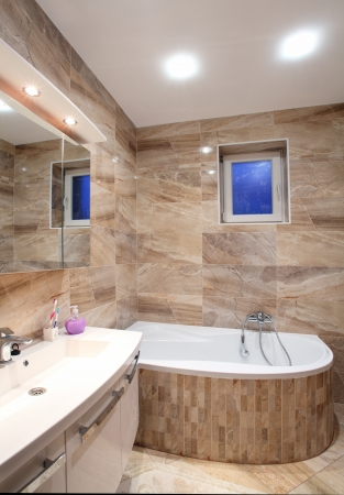 lighting fixtures: bathroom in luxury  home with bath and furniture