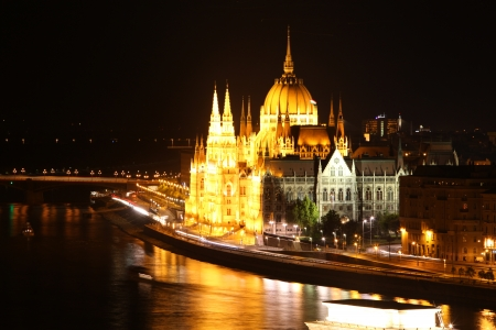 Budapest - Hungarian parliament.with reflection in Danube river at night - Hungary photo