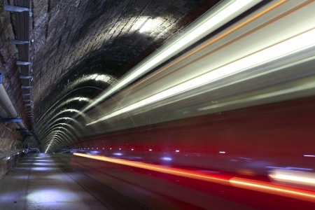 trams: A tram disappearing into a tunnel