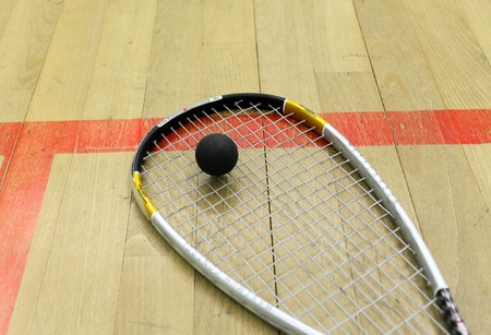 raquet: Squash court and racket with ball Stock Photo