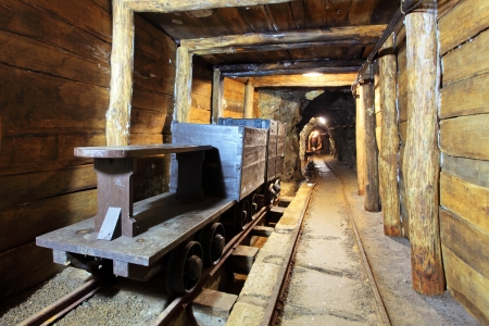 tunneling: Wagons and machine in gold, silver and cooper mine Stock Photo