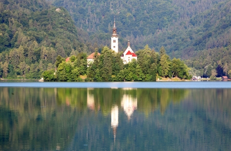 A church on the island in lake Bled in Slovenia photo