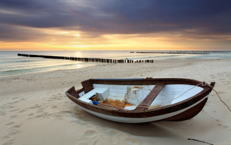 baltic sea: Boat on beautiful beach in sunrise