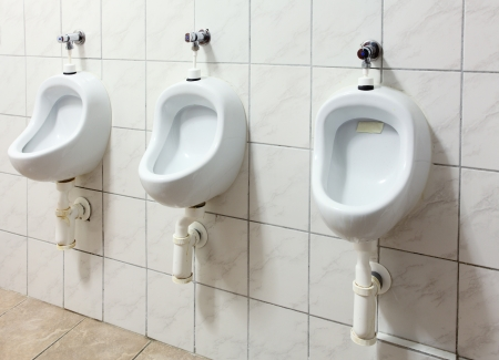 urinal: Tree urinal in public toilet