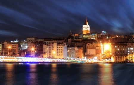 View of Istanbul and Galata tower and bridge at night photo