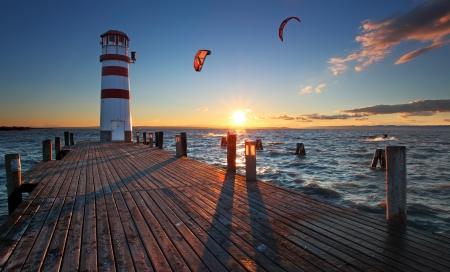 wharf: Lighthouse at Lake Neusiedl at sunset