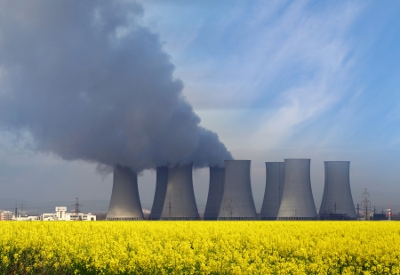 Nuclear power plant with yellow field  Stock Photo - 18080308