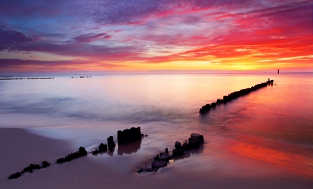 Baltic sea at beautiful sunrise in Poland beach. photo