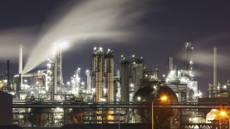 Oil and gas refinery at twilight with reflection - factory - petrochemical plant photo